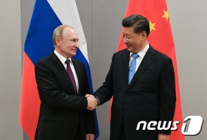 Russian President Putin meets with Chinese President Xi during their meeting on the sideline of the BRICS summit in Brasilia